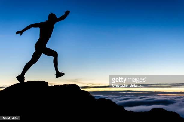 Runner on ridge in sunset