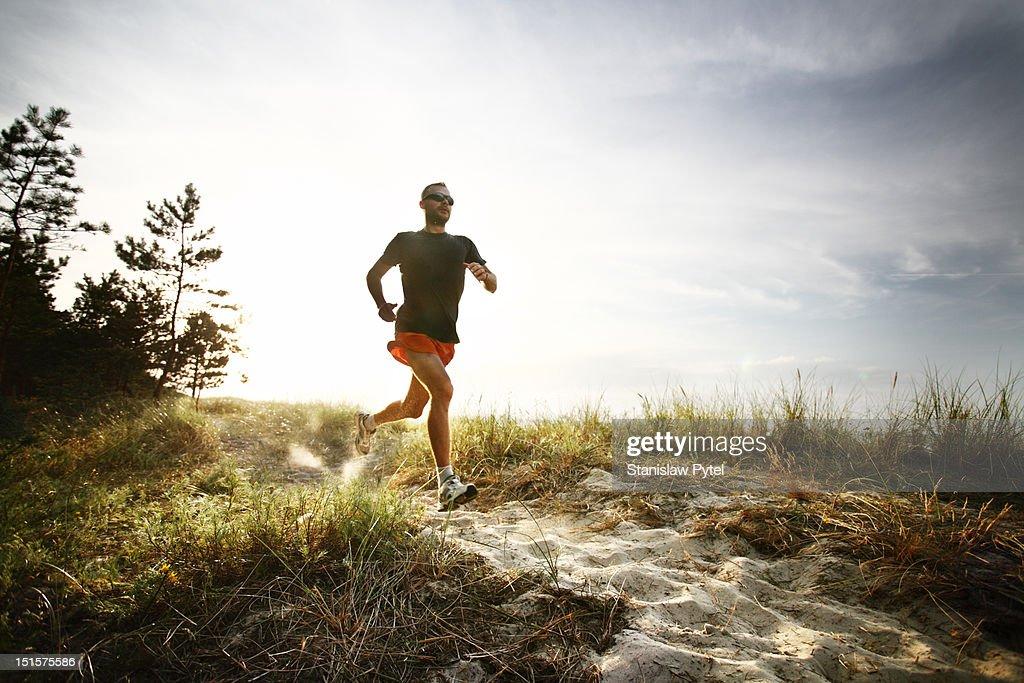 Runner on track at morning : Stock Photo