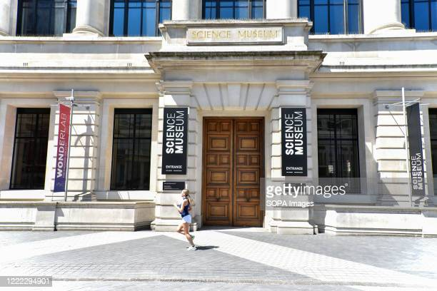 Runner passes the entrance of the Science Museum seen on the day British Prime Minister Boris Johnson announced museums & galleries can reopen in...
