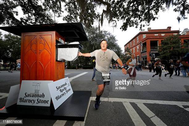 A runner passes the Savannah Blarney Stone during the Humana Rock 'n' Roll Savannah Marathon 1/2 Marathon on November 02 2019 in Savannah United...