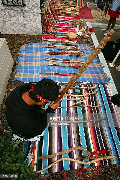 A runner picks up a religious object to carry for the day while morning prayers and Native American cleansing ceremonies are performed as day...