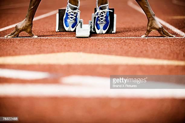 Runner positioned on starting block