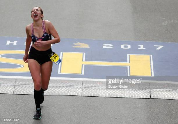 A runner reacts after crossing the finish line of the 121st Boston Marathon in Boston on Apr 17 2017