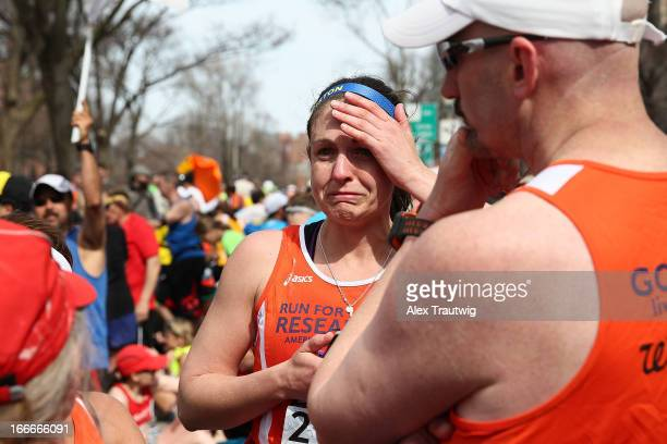 A runner reacts near Kenmore Square after two bombs exploded during the 117th Boston Marathon on April 15 2013 in Boston Massachusetts Two people are...