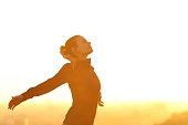 Runner resting breathing fresh air at sunset