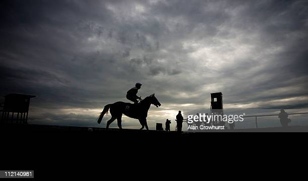 A runner returns after the last race of the day at Newmarket racecourse on April 13 2011 in Newmarket England