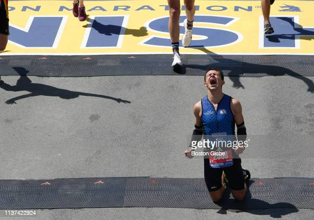 Runner Rodrigo Alves of Brazil reacts after crossing the finish line of the 123rd Boston Marathon on April 15 2019