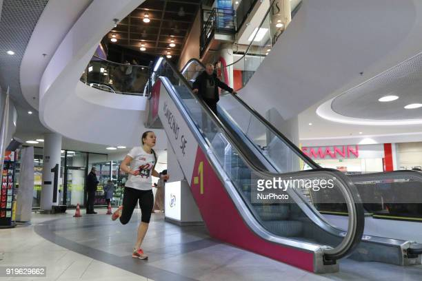 Runner running in front of escalator is seen in Gdansk Poland on 17 February 2018 Runners take part in the Manhattan Run run competition inside the...