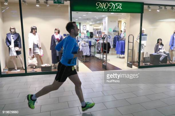 Runner running in front of Mona Pro Moda shop is seen in Gdansk Poland on 17 February 2018 Runners take part in the Manhattan Run run competition...
