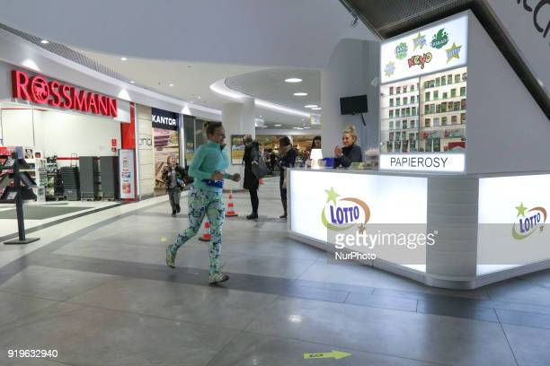 Runner running in front of Rossmann shop is seen in Gdansk Poland on 17 February 2018 Runners take part in the Manhattan Run run competition inside...