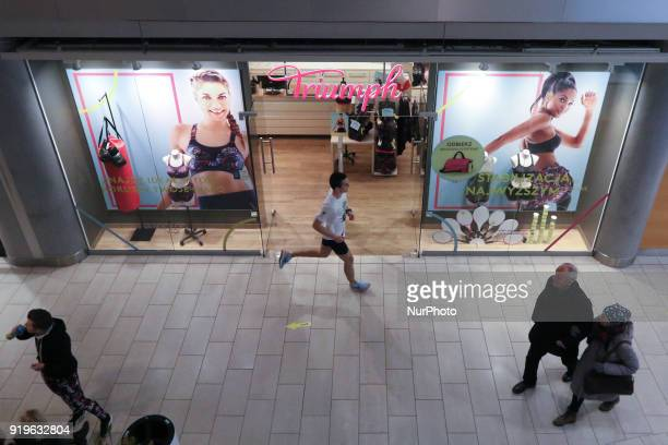 Runner running in front of Triumph shop is seen in Gdansk Poland on 17 February 2018 Runners take part in the Manhattan Run run competition inside...