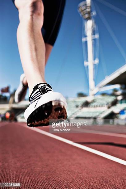 runner running on track - cleats stock pictures, royalty-free photos & images