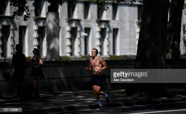 A runner runs along the Embankment on April 26 2020 in London England The 40th London Marathon was due to take place today with thousands of runners...