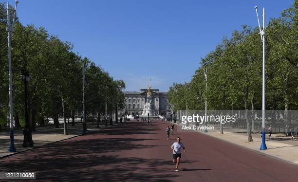 A runner runs down The Mall where the finish of the London Marathon was due to take place on April 26 2020 in London England The 40th London Marathon...