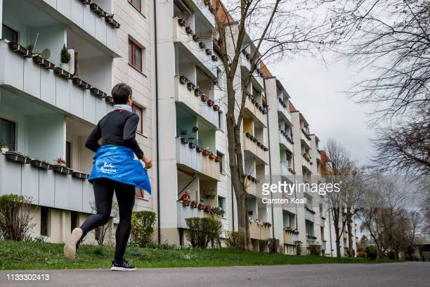 A runner runs in a residential area on March 28 2019 in Bernburg Germany Many mediumsized towns in eastern Germany have seen a steady decline in...