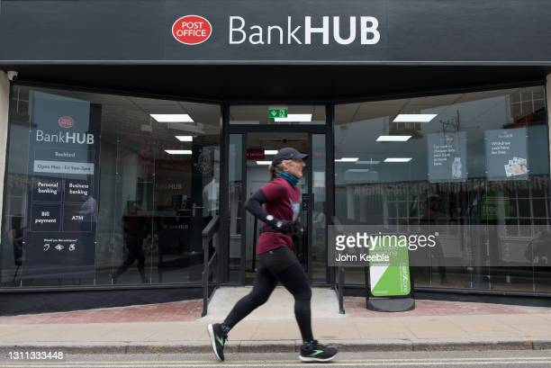 Runner runs past the new Bank Hub on April 7, 2021 in Rochford, England. The new shared 'Banking Hub' organised by the 'Community Access to Cash' in...