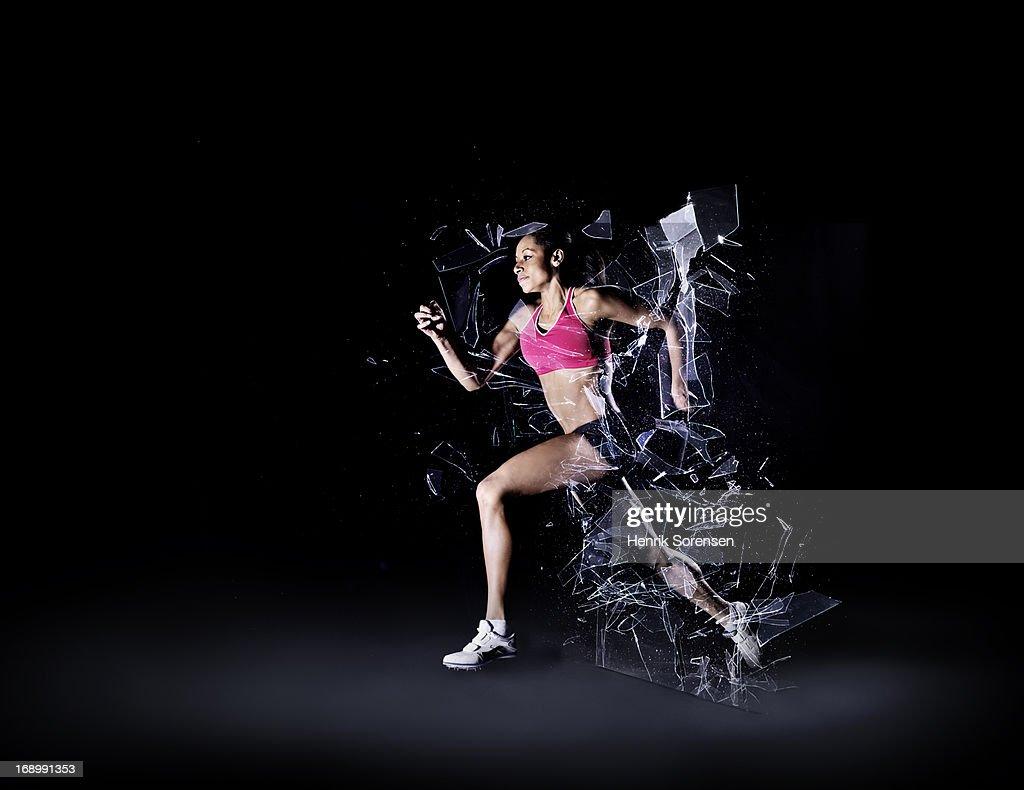 Runner shattering barrier : Stock Photo
