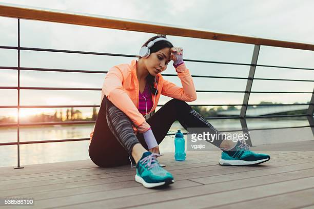 Runner Sitting And Listening Music.