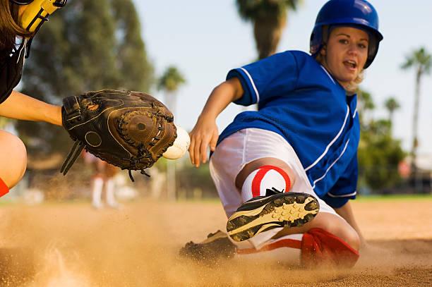Runner Sliding Home as Catcher Grabs Softball