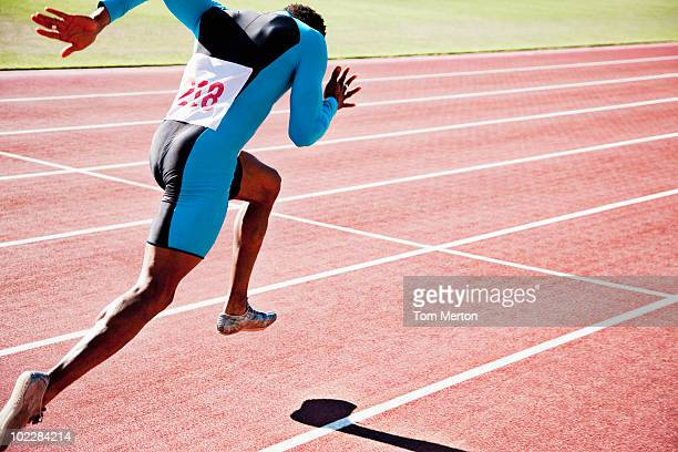 runner sprinting on track - sprinting stock pictures, royalty-free photos & images