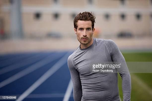 Runner standing on track
