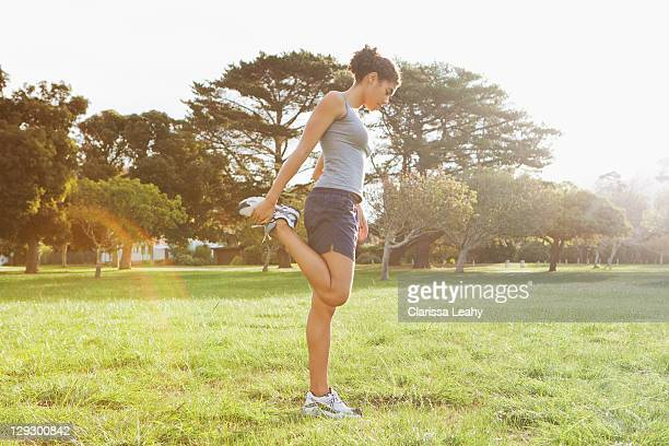 runner stretching in field - constantia stock pictures, royalty-free photos & images