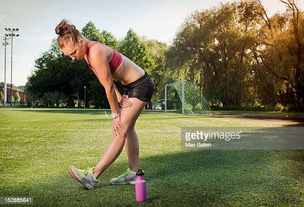 runner stretching on grass in park - lahti finland stockfoto's en -beelden