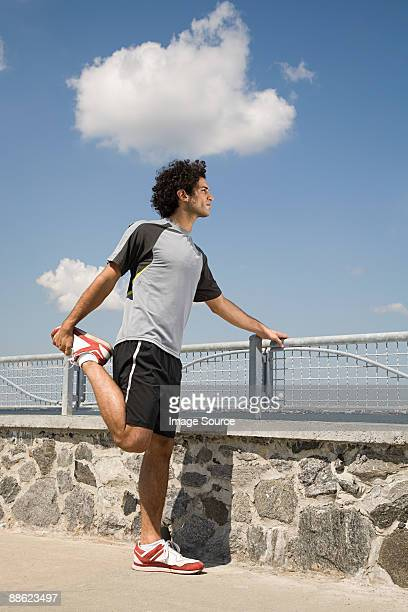 runner stretching - arab feet stock photos and pictures