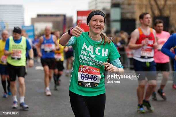 A runner supporting Macmillan Cancer Support gives thumbsup during the Virgin Money London Marathon on April 24 2016 in London England