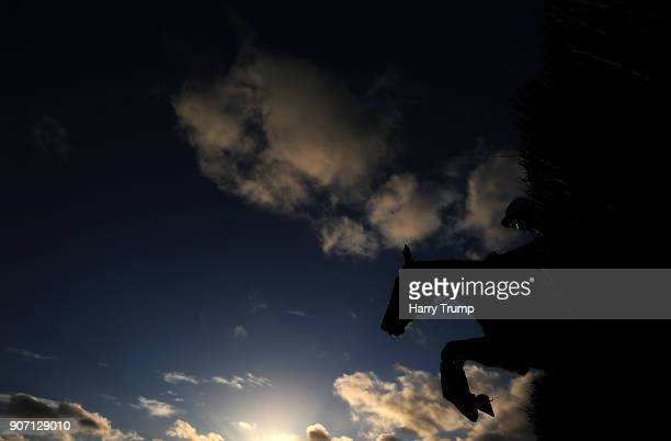 A runner takes a flight during the Download The App at 188Bet Handicap Steeple Chase at Chepstow Racecourse on January 19 2018 in Chepstow Wales