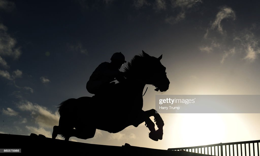 A runner takes a flight during the NFL Betting At 188Bet Conditional Jockeys' Handicap Hurdle at Exeter Racecourse on October 12, 2017 in Exeter, England.
