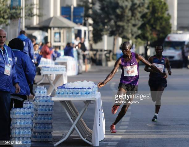 A runner takes a water competing in the 42km marathon within the World's only intercontinental marathon 'Vodafone 40th Istanbul Marathon' in Istanbul...