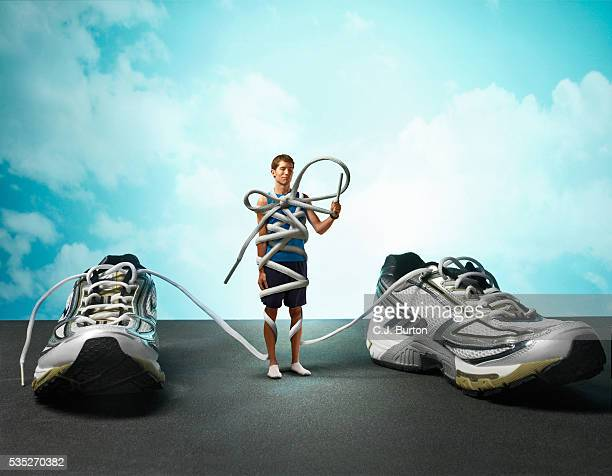 runner tied up in shoelaces - restraining stock pictures, royalty-free photos & images