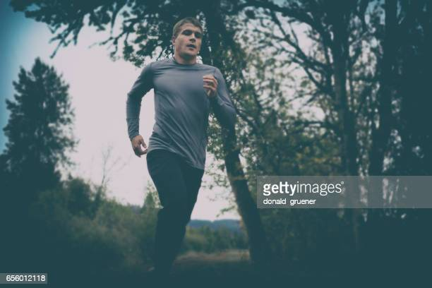runner training on dark moody day - desaturated stock pictures, royalty-free photos & images