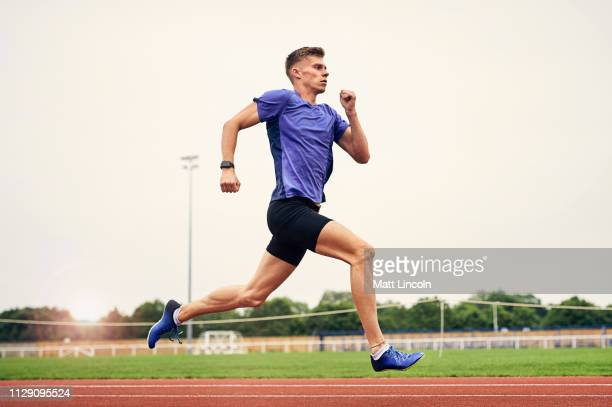 runner training on running track - running stock pictures, royalty-free photos & images