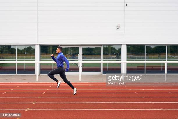 runner training on running track - sports track stock pictures, royalty-free photos & images