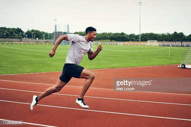 runner training on running track - sports training stock pictures, royalty-free photos & images