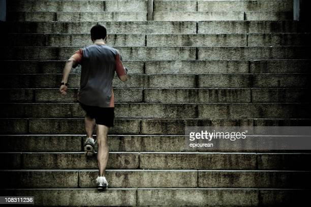 runner training on stair intervals - stairs stock photos and pictures
