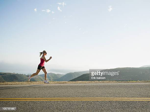 Runner training on the side of the road