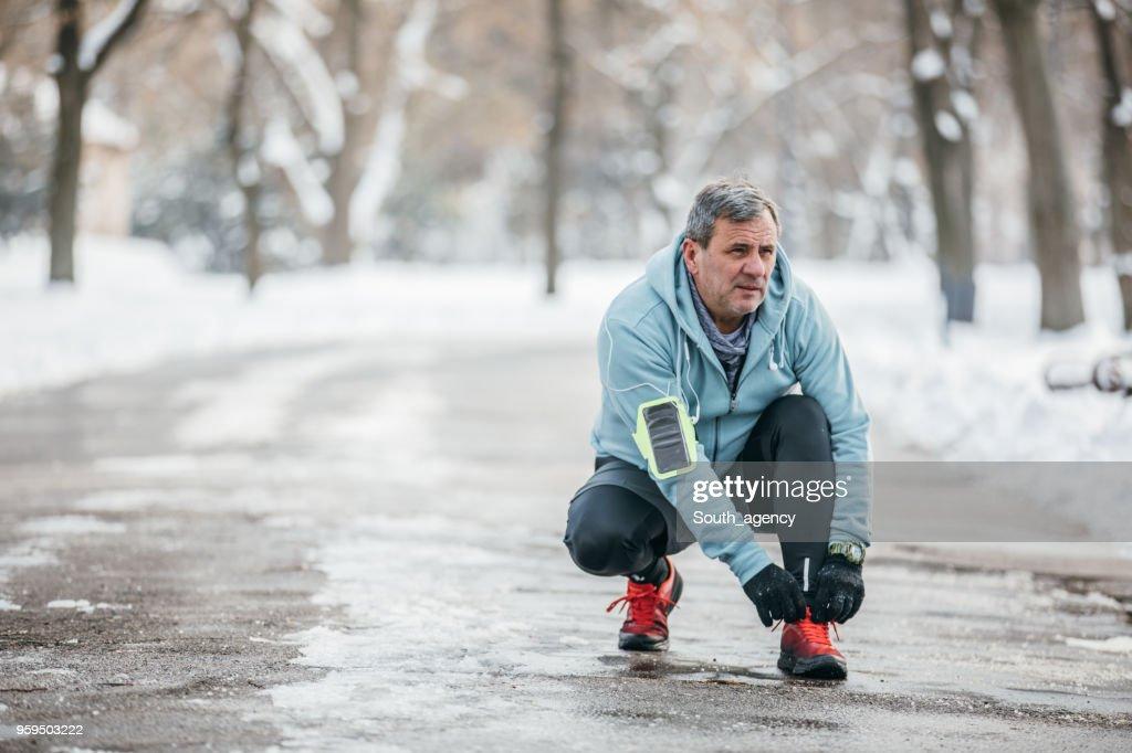 Runner tying shoelace : Stock Photo