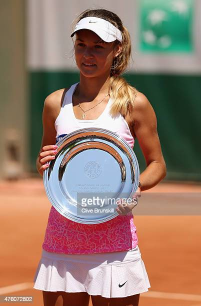 Runner up Anna Kalinskaya of Russia poses with her trophy after the girl's singles final match against Paula Badosa Gibert of Spain on day fourteen...