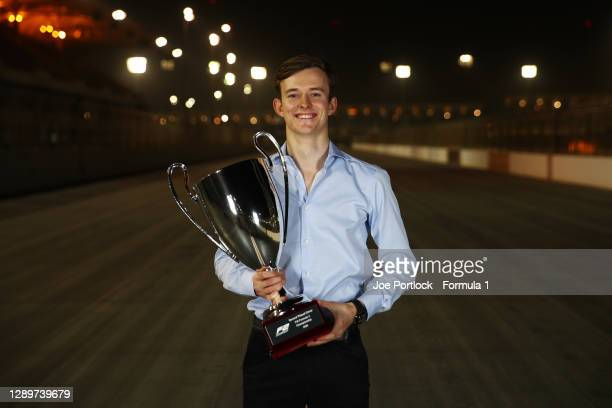 Runner up Callum Ilott of Great Britain and UNI-Virtuosi Racing poses for a photo with his trophy during the Formula 2 Championship Prize Giving...
