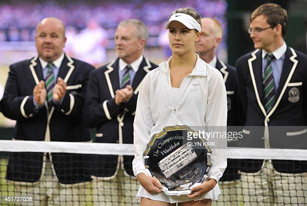 Runner up Canada's Eugenie Bouchard holds her trophy after losing to Czech Republic's Petra Kvitova the women's singles final match on day twelve of...