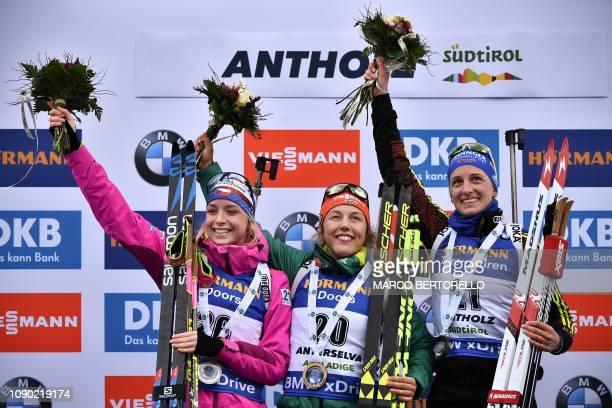 Runner up Czech Republic's Marketa Davidova winner Germany's Laura Dahlmeier and thirdplaced Germany's Vanessa Hinz celebrate on the podium after the...