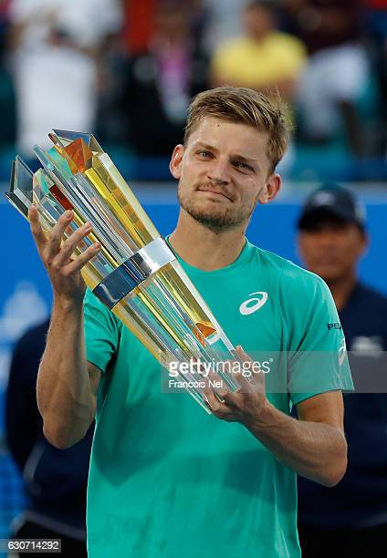Runner up David Goffin of Belgium poses with his trophy after the Final match of the Mubadala World Tennis Championship at Zayed Sport City on...