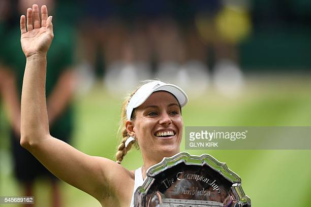 Runner up Germany's Angelique Kerber waves with the runners up dish after losing the women's singles final to US player Serena Williams on the...