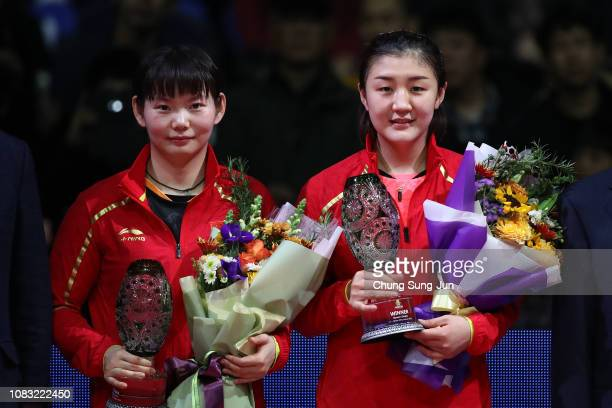 Runner up He Zhuojia of China and Gold medalist Chen Meng of China pose with a trophy during a ceremony after Women's Singles Finals during day four...