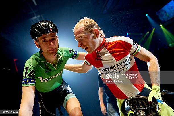 Runner up Jesper Morkov of Denmark and his brother winner Michael Morkov stand at the finish line after the Copenhagen Six Days Cycling Race at...