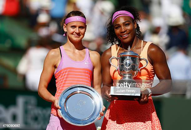 Runner up Lucie Safarova of Czech Republic and winner Serena Williams of the United States pose with their trophys after the Women's Singles Final on...