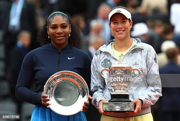 Runner up Serena Williams of the United States and Champion Garbine Muguruza of Spain pose with the trophies following the Ladies Singles final match...